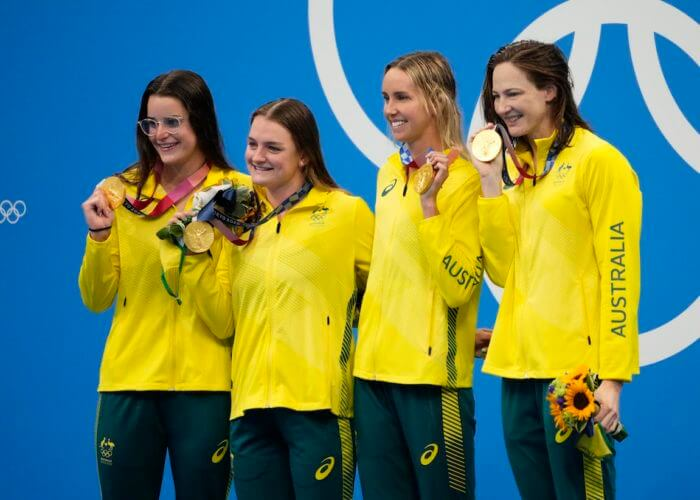 Aug 1, 2021; Tokyo, Japan; Australia relay team of Kaylee McKeown (AUS), Chelsea Hodges (AUS), Emma McKeon (AUS) and Cate Campbell (AUS) during the medals ceremony for the women's 4x100m medley relay during the Tokyo 2020 Olympic Summer Games at Tokyo Aquatics Centre. Mandatory Credit: Rob Schumacher-USA TODAY Sports