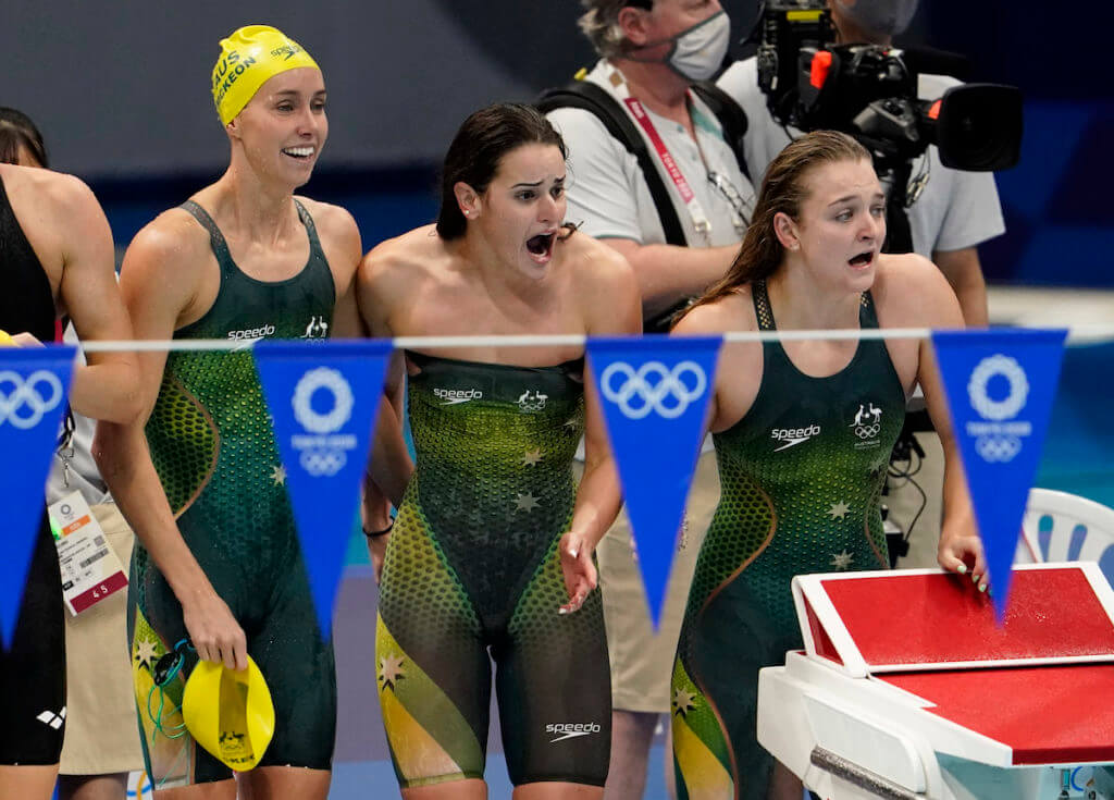 Aug 1, 2021; Tokyo, Japan; Kaylee McKeown (AUS), Chelsea Hodges (AUS) and Emma McKeon (AUS) celebrate their victory in the women's 4x100m medley final during the Tokyo 2020 Olympic Summer Games at Tokyo Aquatics Centre. Mandatory Credit: Rob Schumacher-USA TODAY Sports - Australia