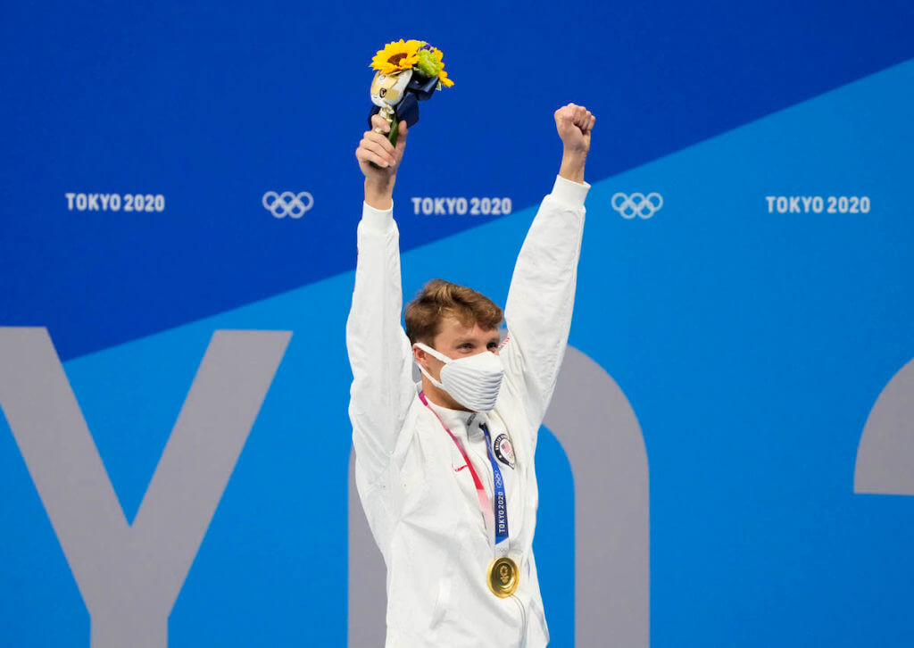 Aug 1, 2021; Tokyo, Japan; Robert Finke (USA) with his gold medal during the medals ceremony for the men's 1500m freestyle during the Tokyo 2020 Olympic Summer Games at Tokyo Aquatics Centre. Mandatory Credit: Rob Schumacher-USA TODAY Sports
