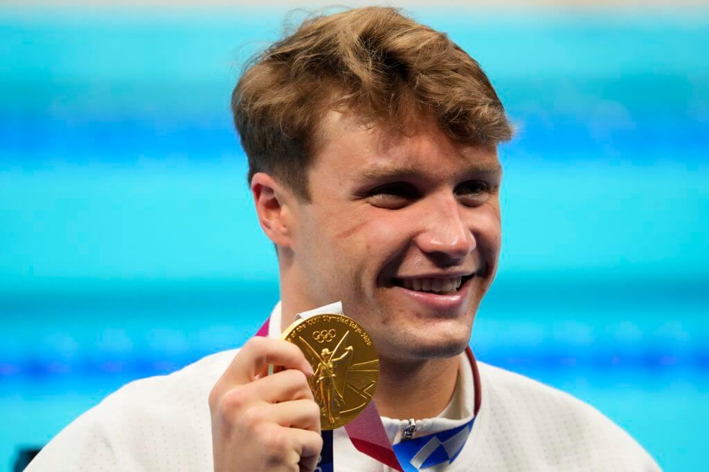 Jul 29, 2021; Tokyo, Japan; Robert Finke (USA) celebrates with his gold medal during the medals ceremony for the men's 800m freestyle during the Tokyo 2020 Olympic Summer Games at Tokyo Aquatics Centre. Mandatory Credit: Rob Schumacher-USA TODAY Sports