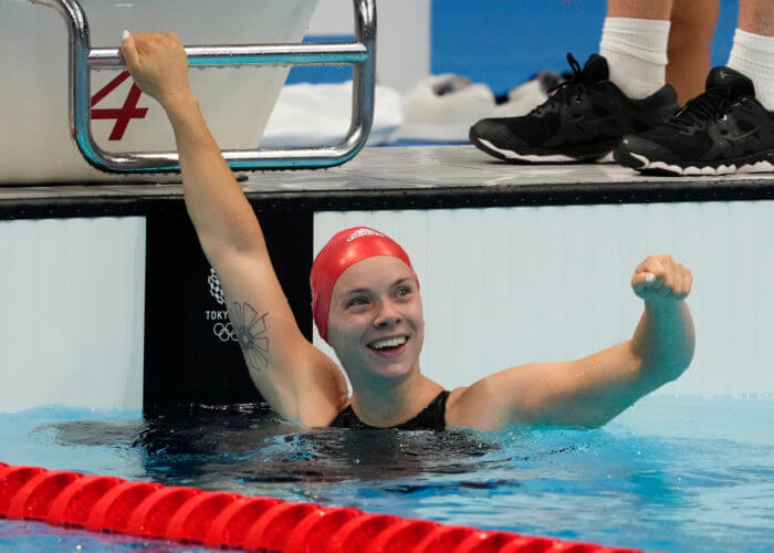 Jul 31, 2021; Tokyo, Japan; Anna Hopkin (GBR) celebrates after anchoring the relay team to victory in the mixed 4x100m medley relay final during the Tokyo 2020 Olympic Summer Games at Tokyo Aquatics Centre. Mandatory Credit: Rob Schumacher-USA TODAY Sports