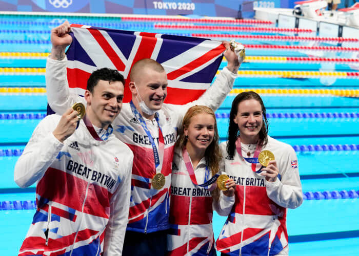 Jul 31, 2021; Tokyo, Japan; Great Britain mixed 4x100m medley relay team celebrate their gold medal during the Tokyo 2020 Olympic Summer Games at Tokyo Aquatics Centre. Mandatory Credit: Rob Schumacher-USA TODAY Sports Adam Peaty