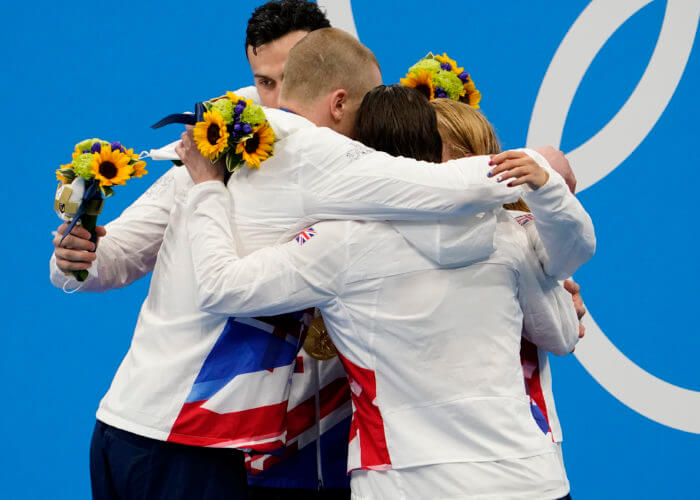 Jul 31, 2021; Tokyo, Japan; Great Britain mixed 4x100m medley relay team celebrate their gold medal during the Tokyo 2020 Olympic Summer Games at Tokyo Aquatics Centre. Mandatory Credit: Rob Schumacher-USA TODAY Sports