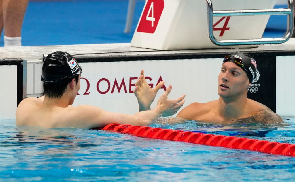 Jul 28, 2021; Tokyo, Japan; Caeleb Dressel (USA) shakes hands with Sunwoo Hwang (KOR) after the men's 100m freestyle semifinals during the Tokyo 2020 Olympic Summer Games at Tokyo Aquatics Centre. Mandatory Credit: Rob Schumacher-USA TODAY Sports