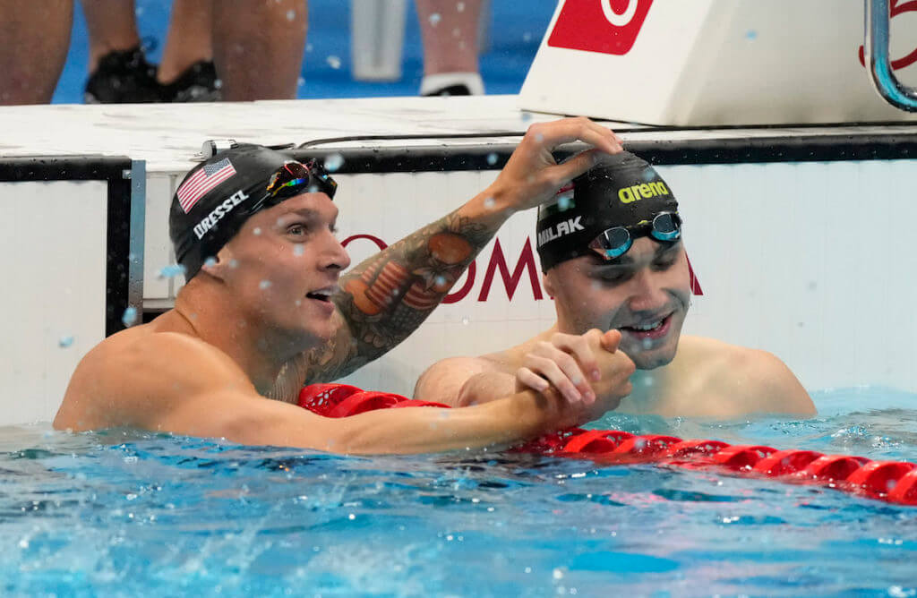 Jul 31, 2021; Tokyo, Japan; Caeleb Dressel (USA) and Kristof Milak (HUN) react after placing first and second in the men's 100m butterfly final during the Tokyo 2020 Olympic Summer Games at Tokyo Aquatics Centre. Mandatory Credit: Rob Schumacher-USA TODAY Sports