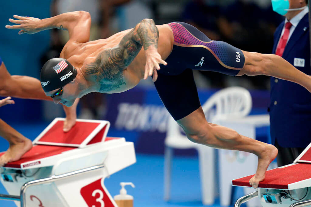 Jul 31, 2021; Tokyo, Japan; Caeleb Dressel (USA) dives into the water at the start of the men's 100m butterfly final during the Tokyo 2020 Olympic Summer Games at Tokyo Aquatics Centre. Mandatory Credit: Grace Hollars-USA TODAY Sports
