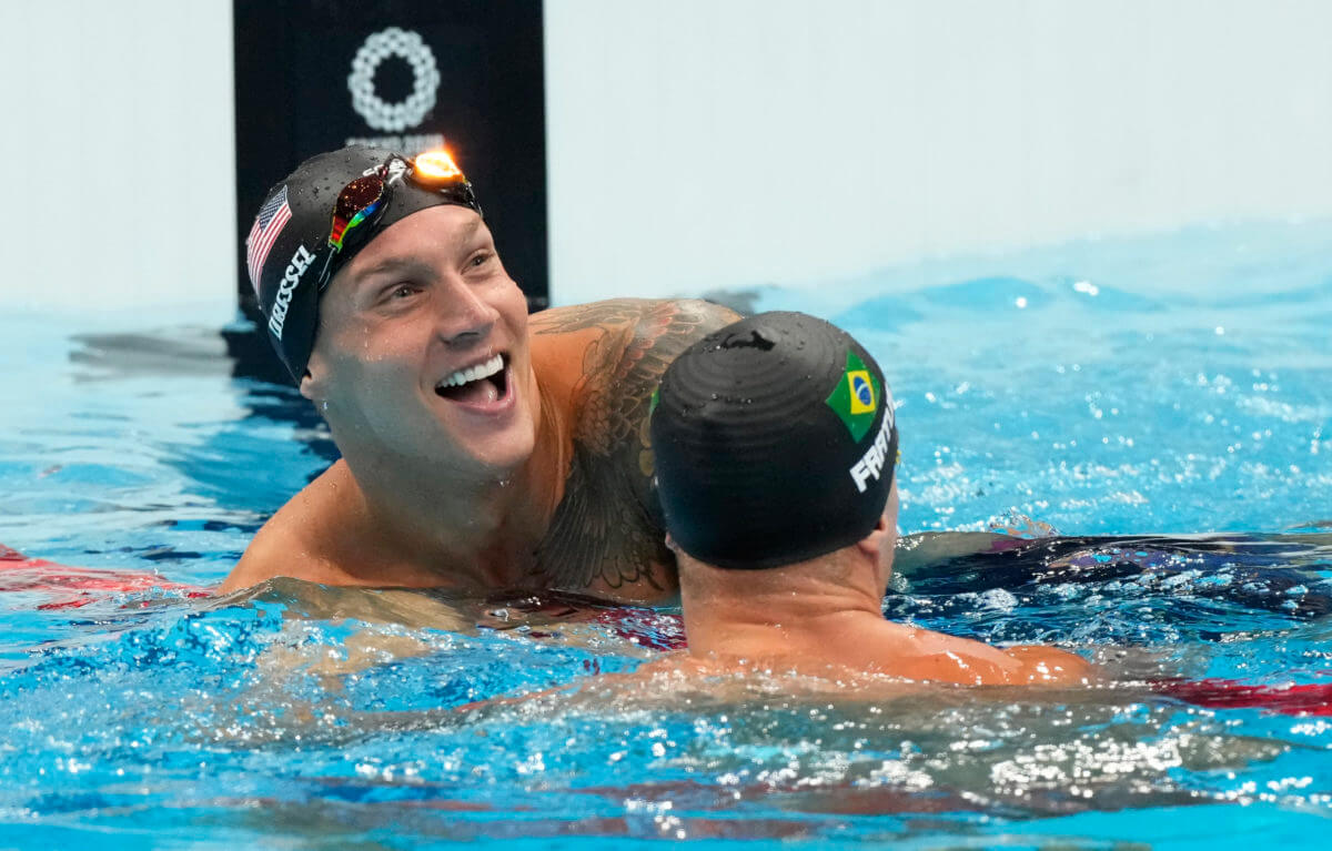 Aug 1, 2021; Tokyo, Japan; Caeleb Dressel (USA) and Bruno Fratus (BRA) react after the men's 50m freestyle final during the Tokyo 2020 Olympic Summer Games at Tokyo Aquatics Centre. Mandatory Credit: Rob Schumacher-USA TODAY Sports