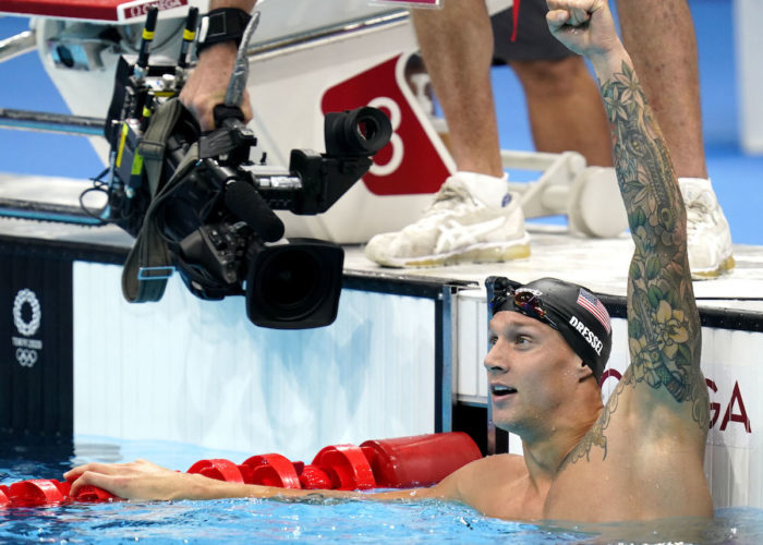 Jul 31, 2021; Tokyo, Japan; Caeleb Dressel (USA) celebrates after winning the men's 100m butterfly final during the Tokyo 2020 Olympic Summer Games at Tokyo Aquatics Centre. Mandatory Credit: Grace Hollars-USA TODAY Sports