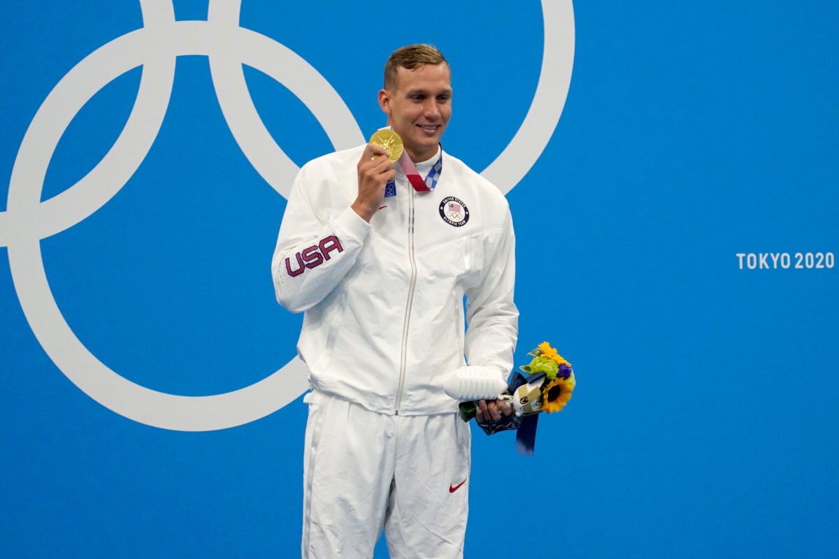 Jul 29, 2021; Tokyo, Japan; Caeleb Dressel (USA) holds up his gold medal after winning the men's 100m freestyle final during the Tokyo 2020 Olympic Summer Games at Tokyo Aquatics Centre. Mandatory Credit: Grace Hollars-USA TODAY Sports
