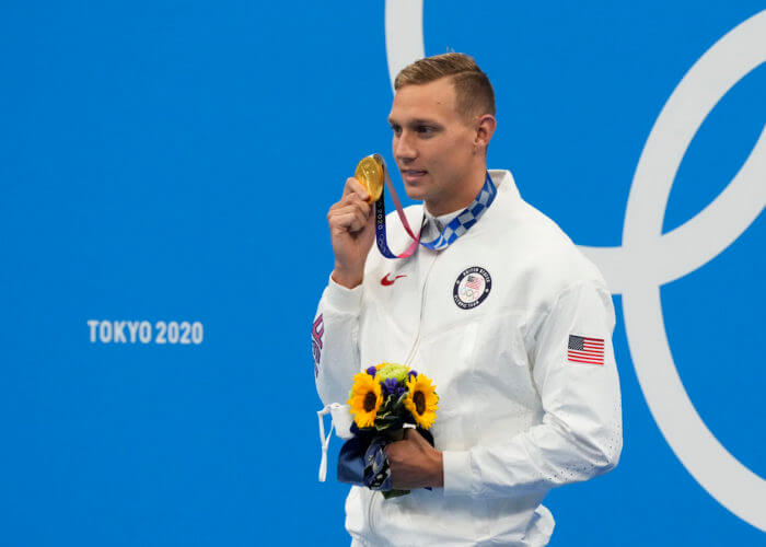 Jul 31, 2021; Tokyo, Japan; Caeleb Dressel (USA) with his gold medal at the medals ceremony for the men's 100m butterfly during the Tokyo 2020 Olympic Summer Games at Tokyo Aquatics Centre. Mandatory Credit: Rob Schumacher-USA TODAY Sports