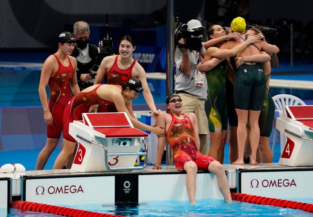Jul 29, 2021; Tokyo, Japan; China relay team celebrates their victory in the women's 4x200m freestyle relay final during the Tokyo 2020 Olympic Summer Games at Tokyo Aquatics Centre. Mandatory Credit: Rob Schumacher-USA TODAY Sports - 800 Freestyle Relay