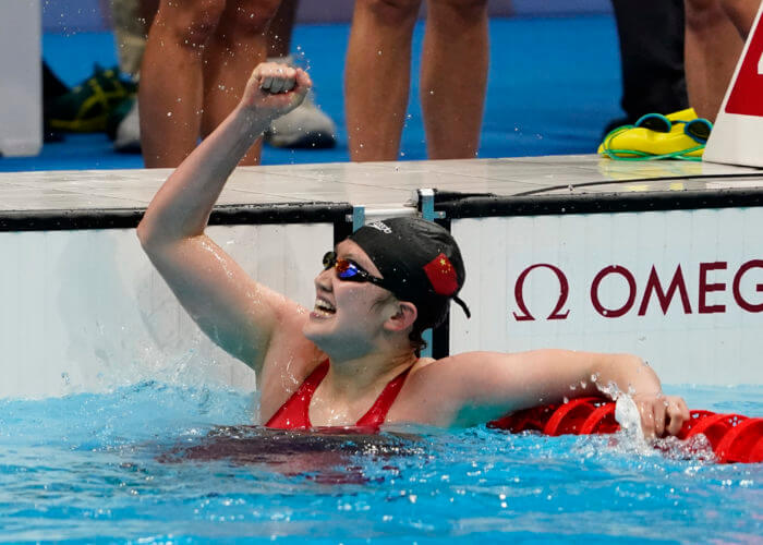 Jul 29, 2021; Tokyo, Japan; Li Bingjie (CHN) celebrates anchoring China to victory in the women's 4x200m freestyle relay final during the Tokyo 2020 Olympic Summer Games at Tokyo Aquatics Centre. Mandatory Credit: Rob Schumacher-USA TODAY Sports