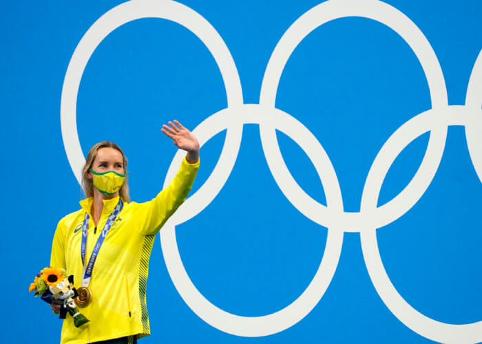 Jul 30, 2021; Tokyo, Japan; Emma McKeon (AUS) celebrates on the podium after winning the women's 100m freestyle final during the Tokyo 2020 Olympic Summer Games at Tokyo Aquatics Centre. Mandatory Credit: Grace Hollars-USA TODAY Sports