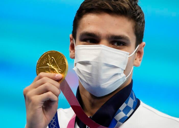 Jul 27, 2021; Tokyo, Japan; Evgeny Rylov (ROC) shows off his gold medal during the medals ceremony for the men's 100m backstroke during the Tokyo 2020 Olympic Summer Games at Tokyo Aquatics Centre. Mandatory Credit: Rob Schumacher-USA TODAY Sports