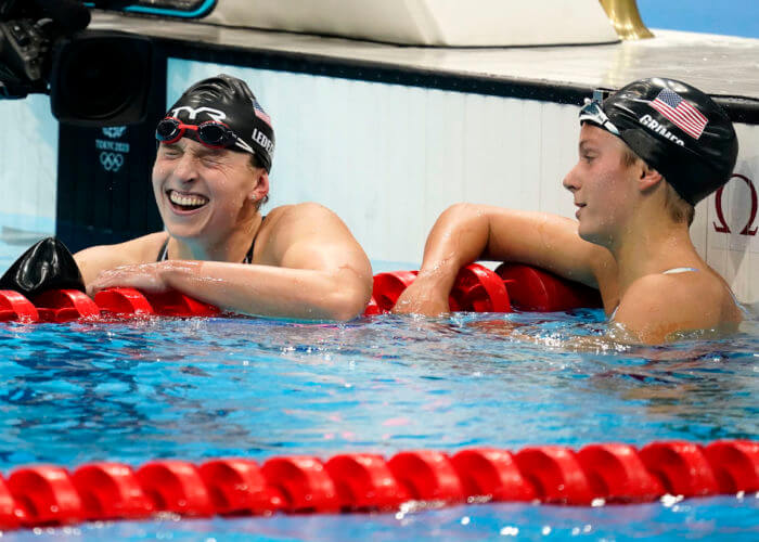 Jul 31, 2021; Tokyo, Japan; Katie Grimes (USA), right) rests next to Katie Ledecky (USA) as Ledecky reacts to winning the women's 800m freestyle final during the Tokyo 2020 Olympic Summer Games at Tokyo Aquatics Centre. Mandatory Credit: Grace Hollars-USA TODAY Sports