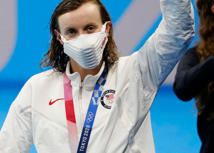 Jul 31, 2021; Tokyo, Japan; Katie Ledecky (USA) celebrates her gold medal during the medals ceremony for the women's 800m freestyle during the Tokyo 2020 Olympic Summer Games at Tokyo Aquatics Centre. Mandatory Credit: Rob Schumacher-USA TODAY Sports