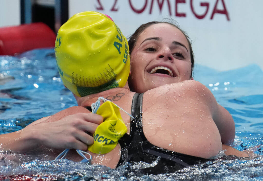 Jul 27, 2021; Tokyo, Japan; Kaylee McKeown (AUS), right, is congratulated by Emily Seebohm (AUS) after winning the women's 100m backstroke final during the Tokyo 2020 Olympic Summer Games at Tokyo Aquatics Centre. Mandatory Credit: Robert Hanashiro-USA TODAY Sports