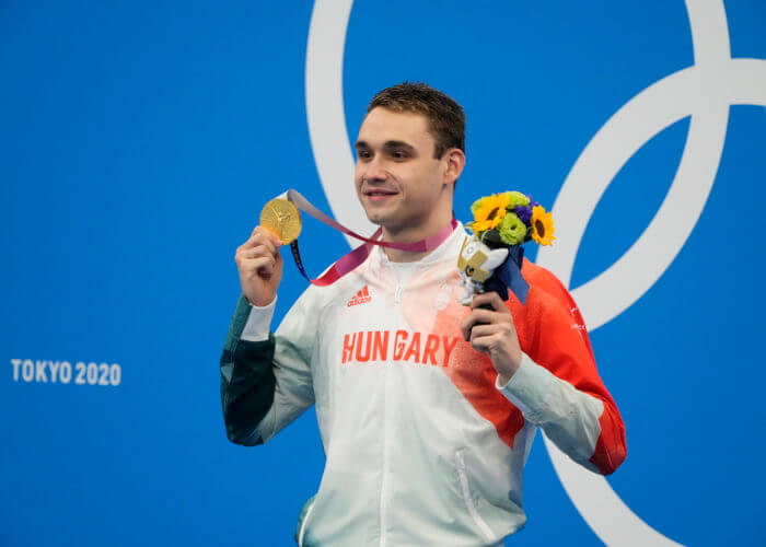 Jul 28, 2021; Tokyo, Japan; Kristof Milak (HUN) with his gold medal during the medals ceremony for the men's 200m butterfly during the Tokyo 2020 Olympic Summer Games at Tokyo Aquatics Centre. Mandatory Credit: Rob Schumacher-USA TODAY Sports