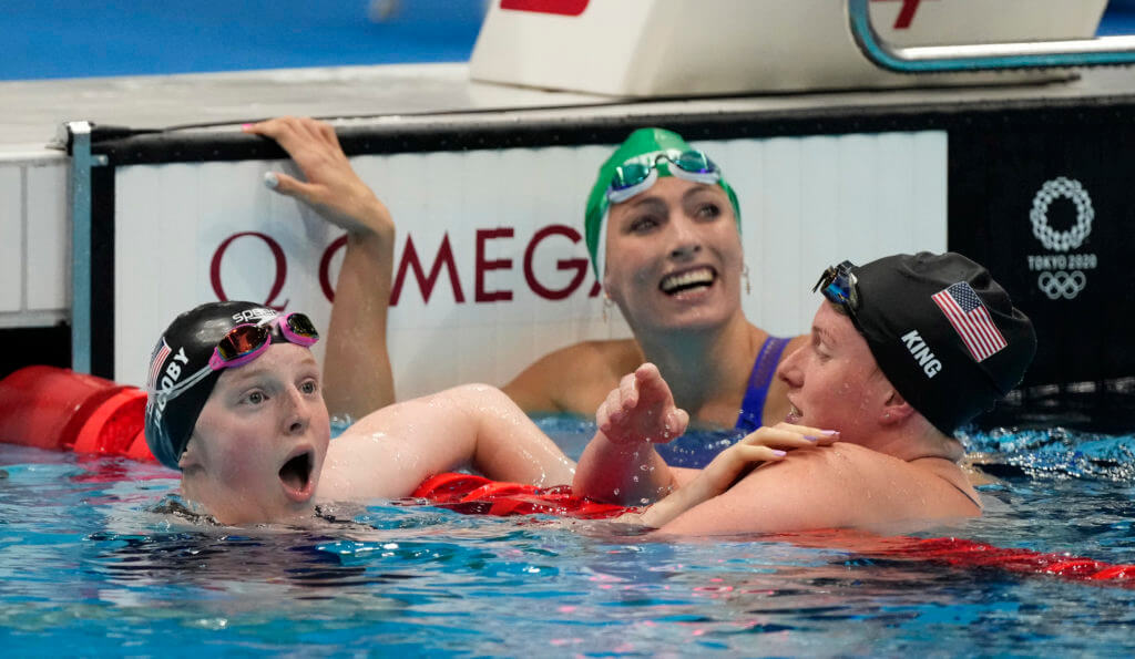 Jul 27, 2021; Tokyo, Japan; Lydia Jacoby (USA), Tatjana Schoenmaker (RSA) and Lilly King (USA) react after finishing first, second and third in the women's 100m breaststroke final during the Tokyo 2020 Olympic Summer Games at Tokyo Aquatics Centre. Mandatory Credit: Rob Schumacher-USA TODAY Sports