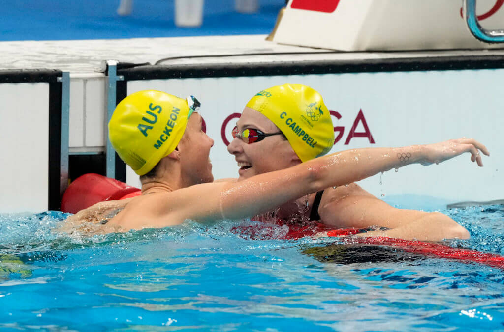 Aug 1, 2021; Tokyo, Japan; Emma McKeon (AUS) celebrates with Cate Campbell (AUS) after winning the women's 50m freestyle final during the Tokyo 2020 Olympic Summer Games at Tokyo Aquatics Centre. Mandatory Credit: Rob Schumacher-USA TODAY Sports