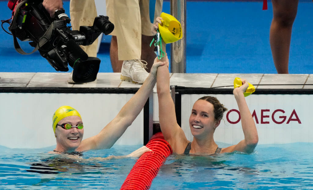 Jul 30, 2021; Tokyo, Japan; Emma McKeon (AUS) and Cate Campbell (AUS) place first and third in the women's 100m freestyle final during the Tokyo 2020 Olympic Summer Games at Tokyo Aquatics Centre. Mandatory Credit: Rob Schumacher-USA TODAY Sports