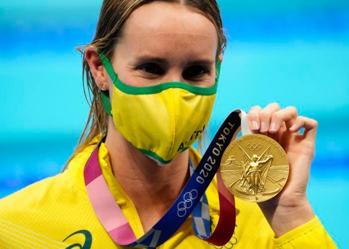 Aug 1, 2021; Tokyo, Japan; Emma McKeon (AUS) with her gold medal during the medals ceremony for the women's 50m freestyle during the Tokyo 2020 Olympic Summer Games at Tokyo Aquatics Centre. Mandatory Credit: Robert Hanashiro-USA TODAY Sports