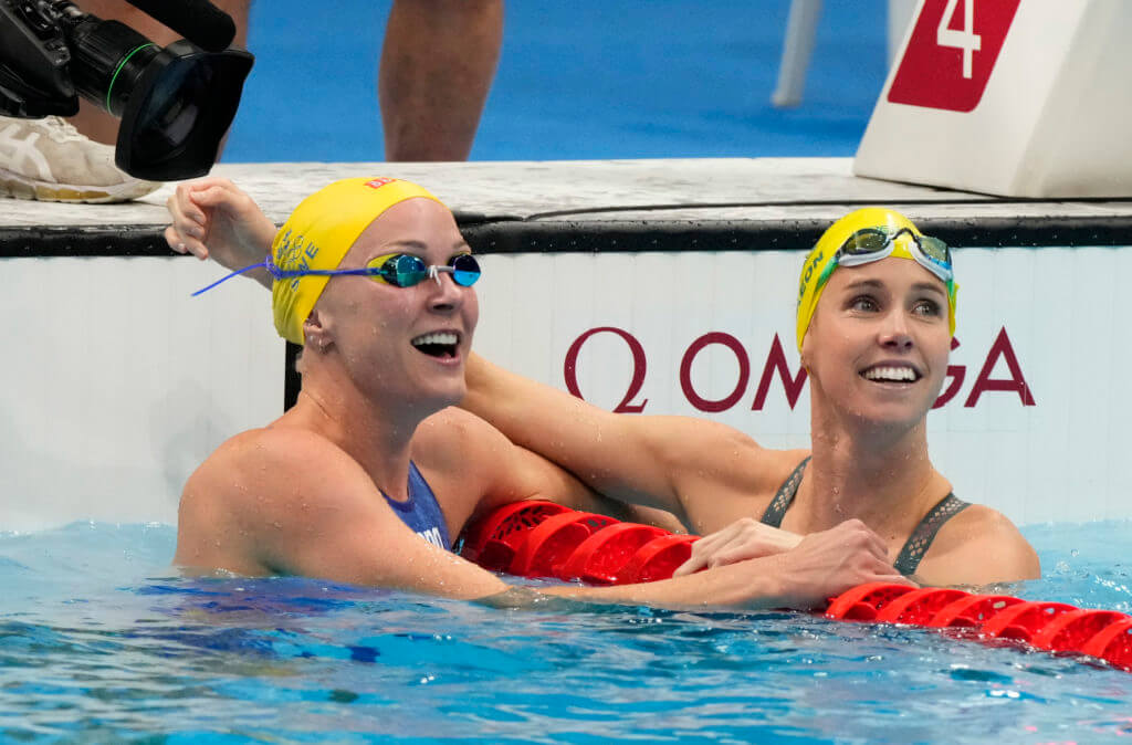 Aug 1, 2021; Tokyo, Japan; Emma McKeon (AUS) and Sarah Sjoestroem (SWE) celebrate their first and second place finishes in the women's 50m freestyle final during the Tokyo 2020 Olympic Summer Games at Tokyo Aquatics Centre. Mandatory Credit: Rob Schumacher-USA TODAY Sports