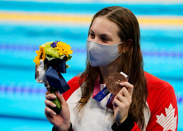 Jul 28, 2021; Tokyo, Japan; Penny Oleksiak (CAN) with her bronze medal during the medals ceremony for the women's 200m freestyle during the Tokyo 2020 Olympic Summer Games at Tokyo Aquatics Centre. Mandatory Credit: Rob Schumacher-USA TODAY Sports
