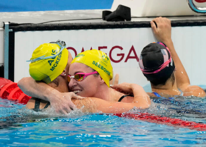 Jul 31, 2021; Tokyo, Japan; Kaylee McKeown (AUS) and Emily Seebohm (AUS) celebrate finishing first and third in the women's 200m backstroke final during the Tokyo 2020 Olympic Summer Games at Tokyo Aquatics Centre. Mandatory Credit: Rob Schumacher-USA TODAY Sports