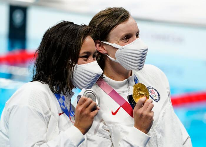 Jul 28, 2021; Tokyo, Japan; Erica Sullivan (USA) and Katie Ledecky (USA) show off their silver and gold medals during the medals ceremony for the women's 1500m freestyle during the Tokyo 2020 Olympic Summer Games at Tokyo Aquatics Centre. Mandatory Credit: Rob Schumacher-USA TODAY Sports