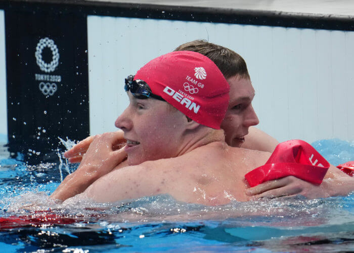 Jul 27, 2021; Tokyo, Japan; Tom Dean (GBR) and Duncan Scott (GBR) celebrate after placing first and second in the men's 200m freestyle final during the Tokyo 2020 Olympic Summer Games at Tokyo Aquatics Centre. Mandatory Credit: Robert Hanashiro-USA TODAY Sports