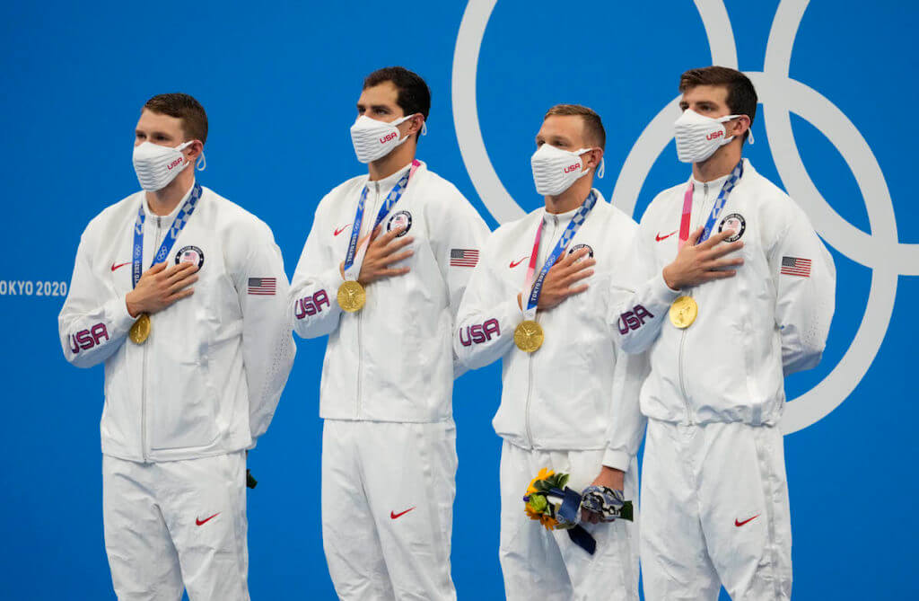 Aug 1, 2021; Tokyo, Japan; Ryan Murphy (USA) , Michael Andrew (USA) , Caeleb Dressel (USA) and Zach Apple (USA) celebrate during the medals ceremony for the men's 4x100m medley relay during the Tokyo 2020 Olympics at Tokyo Aquatics Centre. Mandatory Credit: Rob Schumacher-USA TODAY Sports