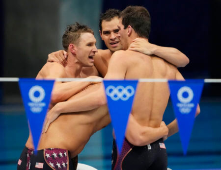 Aug 1, 2021; Tokyo, Japan; Ryan Murphy (USA) and Caeleb Dressel (USA) and Zach Apple (USA) celebrate after winning the men's 4x100m medley final during the Tokyo 2020 Olympic Summer Games at Tokyo Aquatics Centre. Mandatory Credit: Rob Schumacher-USA TODAY Sports