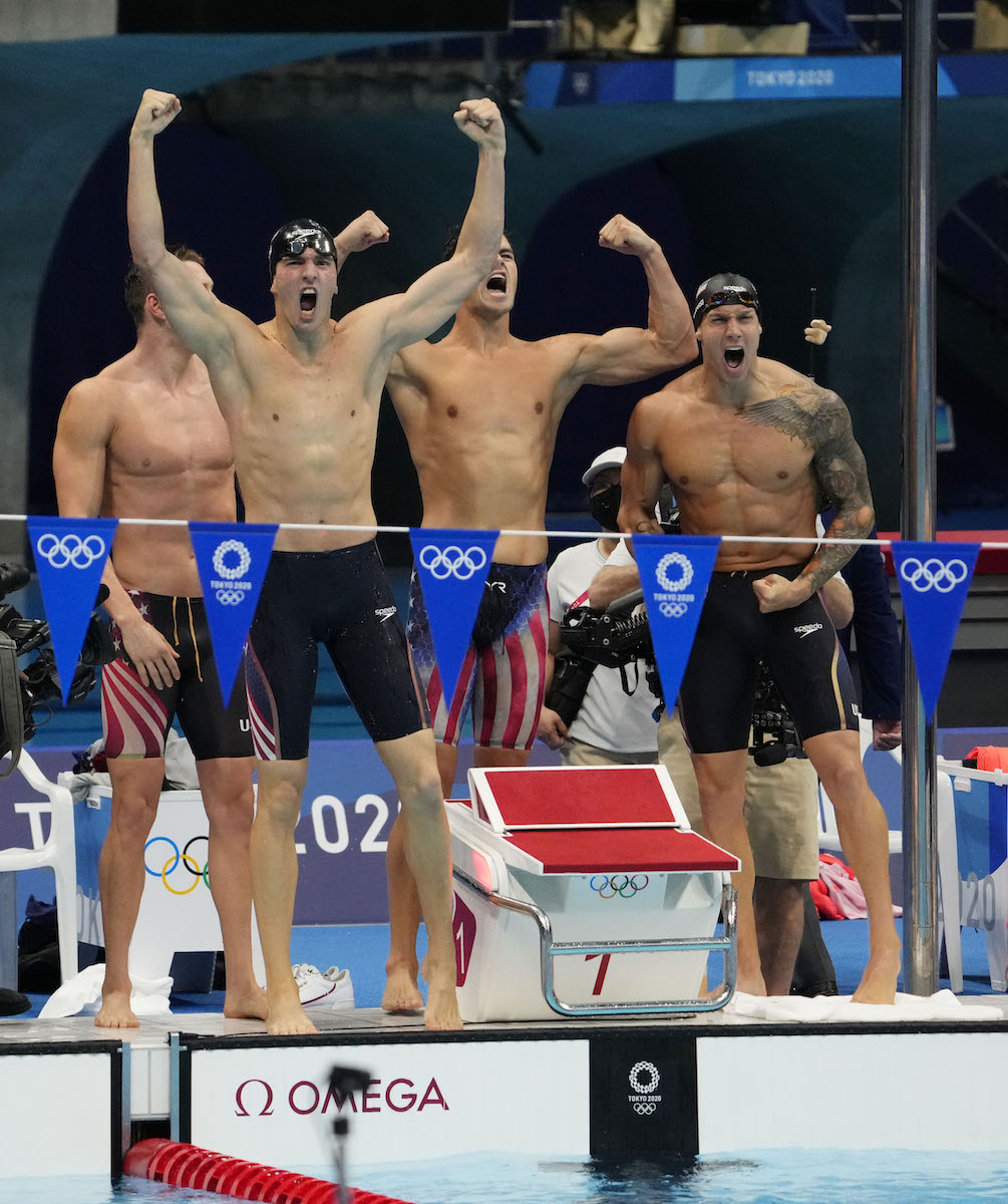 Aug 1, 2021; Tokyo, Japan; Ryan Murphy (USA) and Caeleb Dressel (USA) and Zach Apple (USA) and Michael Andrew (USA) celebrate after winning the men's 4x100m medley final during the Tokyo 2020 Olympic Summer Games at Tokyo Aquatics Centre. Mandatory Credit: Rob Schumacher-USA TODAY Sports