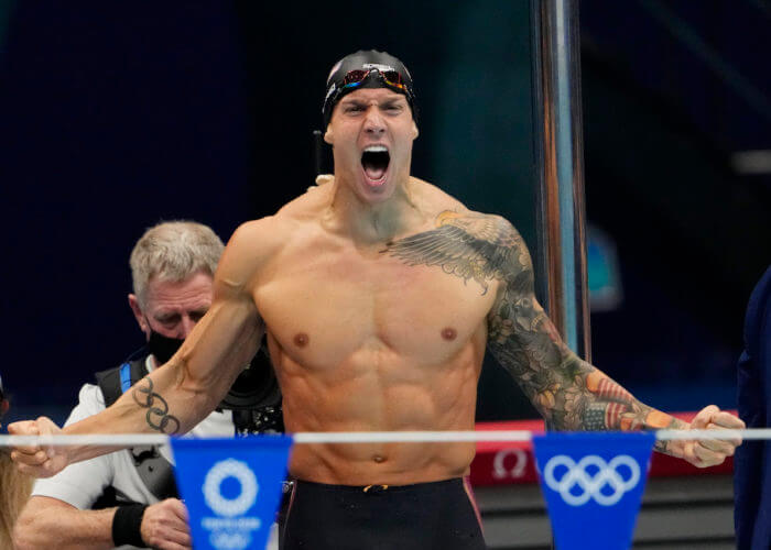 Aug 1, 2021; Tokyo, Japan; Caeleb Dressel (USA) celebrates after winning the men's 4x100m medley final during the Tokyo 2020 Olympic Summer Games at Tokyo Aquatics Centre. Mandatory Credit: Rob Schumacher-USA TODAY Sports