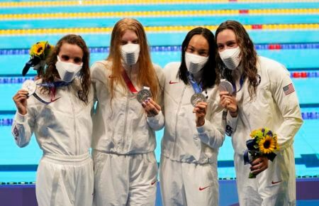 Aug 1, 2021; Tokyo, Japan; USA medalists Regan Smith (USA) , Lydia Jacoby (USA) , Torri Huske (USA) and Abbey Weitzeil (USA) pose with silver medals during the medals ceremony for the women's 4x100m medley relay during the Tokyo 2020 Olympics at Tokyo Aquatics Centre. Mandatory Credit: Rob Schumacher-USA TODAY Sports