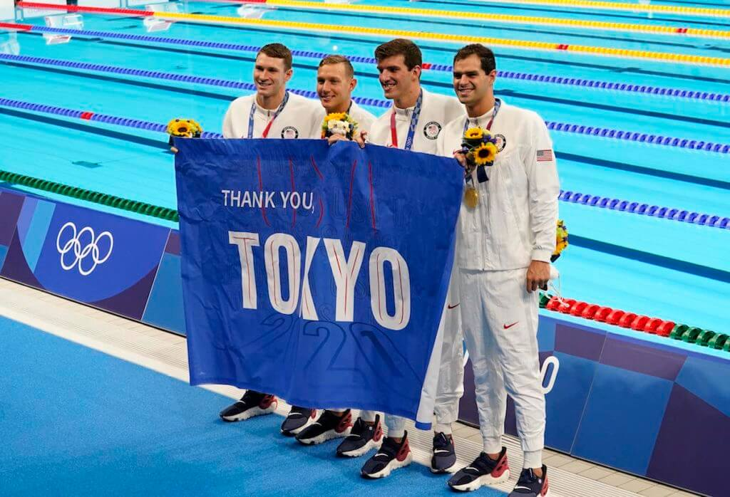 Aug 1, 2021; Tokyo, Japan; Ryan Murphy (USA) , Michael Andrew (USA) , Caeleb Dressel (USA) and Zach Apple (USA) celebrate during the medals ceremony for the men's 4x100m medley relay during the Tokyo 2020 Olympic Summer Games at Tokyo Aquatics Centre. Mandatory Credit: Rob Schumacher-USA TODAY Sports