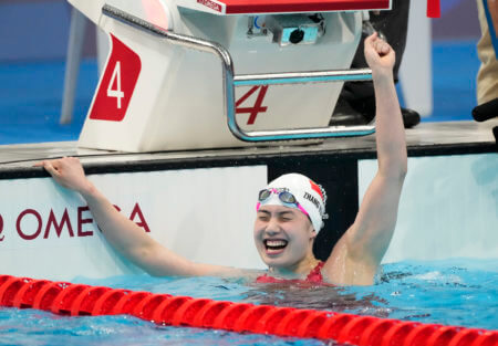 Jul 29, 2021; Tokyo, Japan; Zhang Yufei (CHN) celebrates after winning the women's 200m butterfly final during the Tokyo 2020 Olympic Summer Games at Tokyo Aquatics Centre. Mandatory Credit: Rob Schumacher-USA TODAY Sports