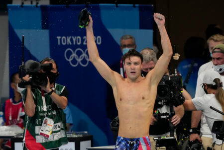 Aug 1, 2021; Tokyo, Japan; Robert Finke (USA) celebrates after winning the men's 1500m freestyle final during the Tokyo 2020 Olympic Summer Games at Tokyo Aquatics Centre. Mandatory Credit: Rob Schumacher-USA TODAY Sports