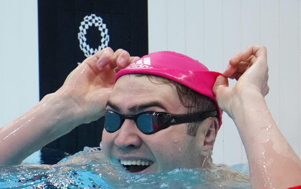 Jul 27, 2021; Tokyo, Japan; Kliment Kolesnikov (ROC) reacts after placing second in the men's 100m backstroke final during the Tokyo 2020 Olympic Summer Games at Tokyo Aquatics Centre. Mandatory Credit: Robert Hanashiro-USA TODAY Sports