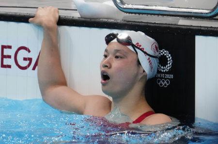 Jul 26, 2021; Tokyo, Japan; Margaret Macneil (CAN) reacts after winning the women's 100m butterfly final during the Tokyo 2020 Olympic Summer Games at Tokyo Aquatics Centre. Mandatory Credit: Robert Hanashiro-USA TODAY Sports