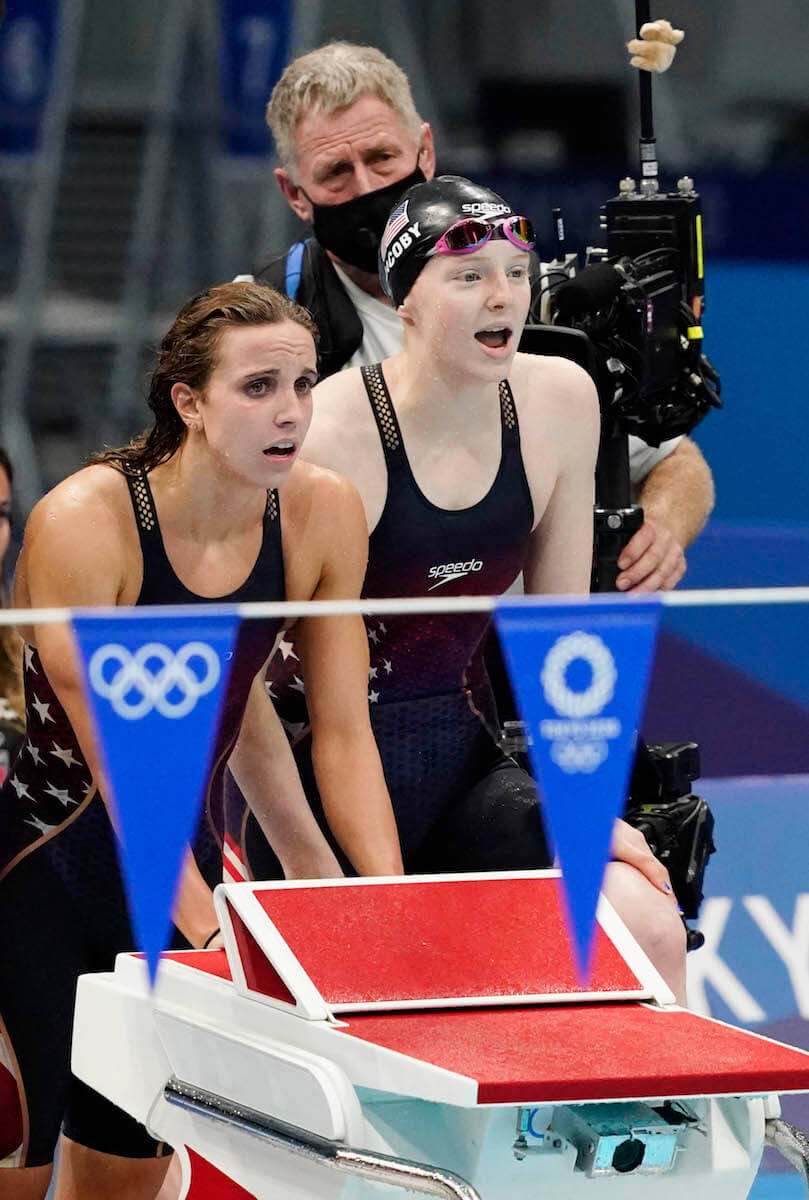 Aug 1, 2021; Tokyo, Japan; Regan Smith (USA) and Lydia Jacoby (USA) watch the women's 4x100m medley final during the Tokyo 2020 Olympic Summer Games at Tokyo Aquatics Centre. Mandatory Credit: Rob Schumacher-USA TODAY Sports