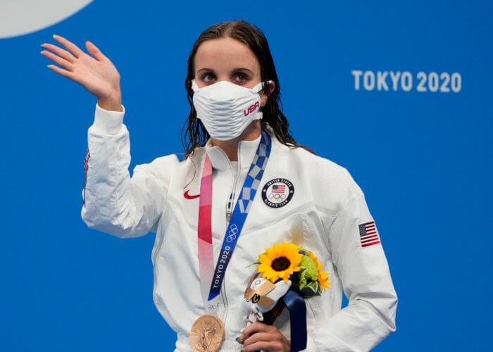 Jul 27, 2021; Tokyo, Japan; Regan Smith (USA) celebrates her bronze medal in the women's 100m backstroke final during the Tokyo 2020 Olympic Summer Games at Tokyo Aquatics Centre. Mandatory Credit: Robert Hanashiro-USA TODAY Sports