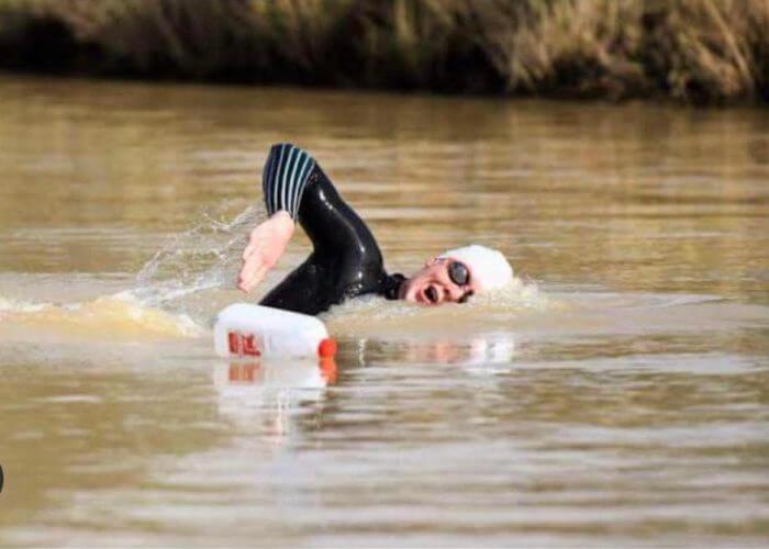 Col swimming on farm