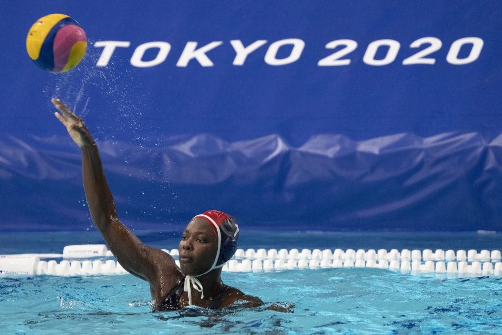 July 24, 2021; Tokyo, Japan; Team United States goalkeeper Ashleigh Johnson (1) passes the ball during the fourth quarter in the preliminary round Group B match against Japan during the Tokyo 2020 Olympic Summer Games at Tatsumi Water Polo Centre. Mandatory Credit: Kyle Terada-USA TODAY Network