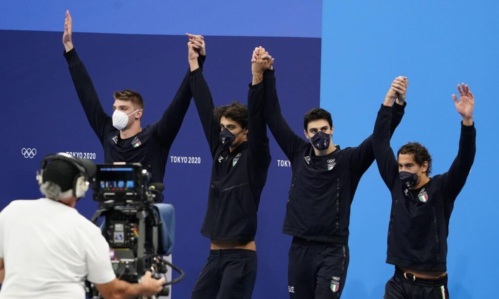 Jul 26, 2021; Tokyo, Japan; Italy relay team celebrates on the podium in the medals ceremony for the men's 4x100m freestyle relay during the Tokyo 2020 Olympic Summer Games at Tokyo Aquatics Centre. Mandatory Credit: Rob Schumacher-USA TODAY Sports