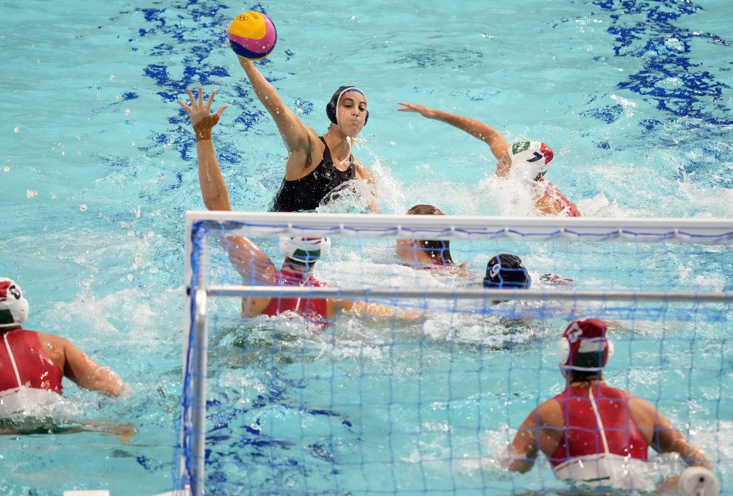Jul 28, 2021; Tokyo, Japan; USA player Margaret Steffens (6) takes a shot against Hungary in a group B match during the Tokyo 2020 Olympic Summer Games at Tatsumi Water Polo Centre. Mandatory Credit: James Lang-USA TODAY Sports