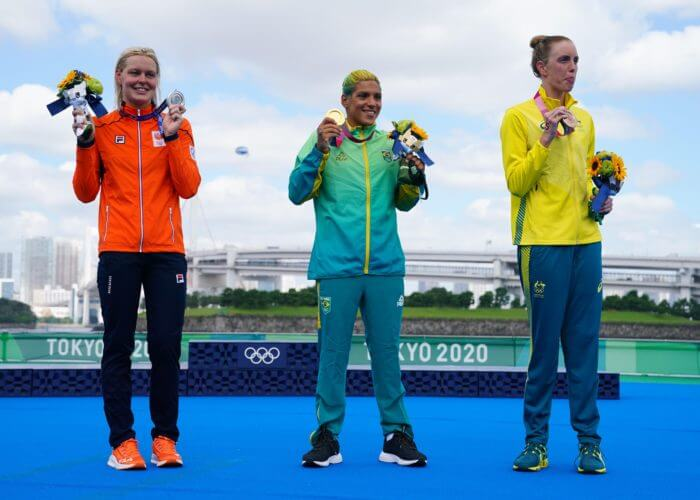 Aug 4, 2021; Tokyo, Japan; Medalists from left Sharon van Rouwendaal (NED), Ana Marcela Cunha (BRA) and Kareena Lee (AUS) after the women's 10km open water swimming competition during the Tokyo 2020 Olympic Summer Games at Odaiba Marine Park. Mandatory Credit: Kareem Elgazzar-USA TODAY Sports