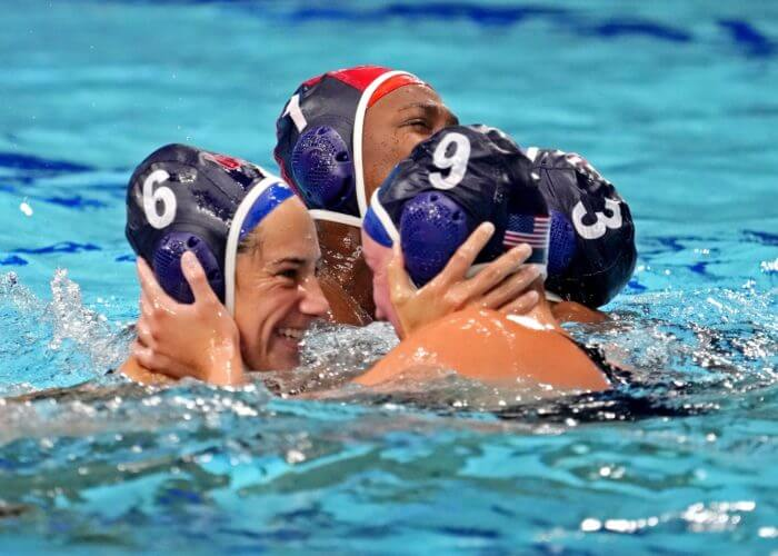 Aug 7, 2021; Tokyo, Japan; United States driver Margaret Steffens (6) and centre forward Aria Fischer (9) celebrates after beating Spain in the women's waterpolo gold medal match during the Tokyo 2020 Olympic Summer Games at Tatsumi Water Polo Centre. Mandatory Credit: Robert Deutsch-USA TODAY Sports