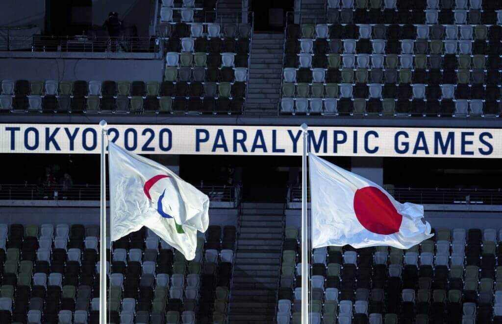 Aug 24, 2021; Tokyo, Japan; The Paralympic flag and the national flag of Japan flying during the Opening Ceremony of the Tokyo 2020 Paralympic Games. Mandatory Credit: Bob Martin/OIS Handout Photo via USA TODAY Sports